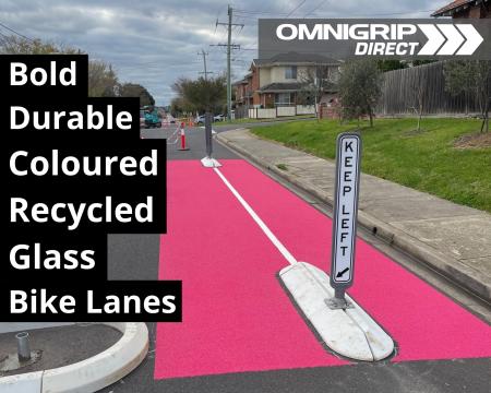 Pink coloured recycled-glass bike lane