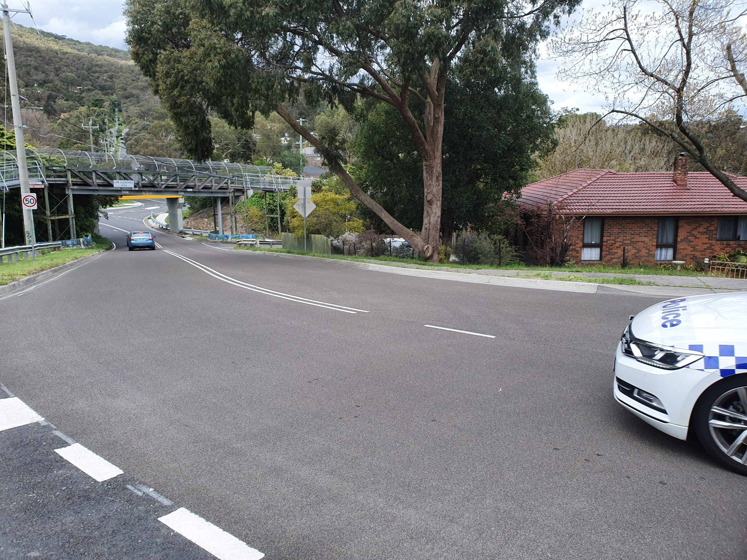 High friction surface treatment on bend in road