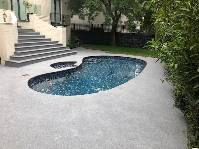 OmniGrip Rubber Coat slip resistant finish surrounding a pool