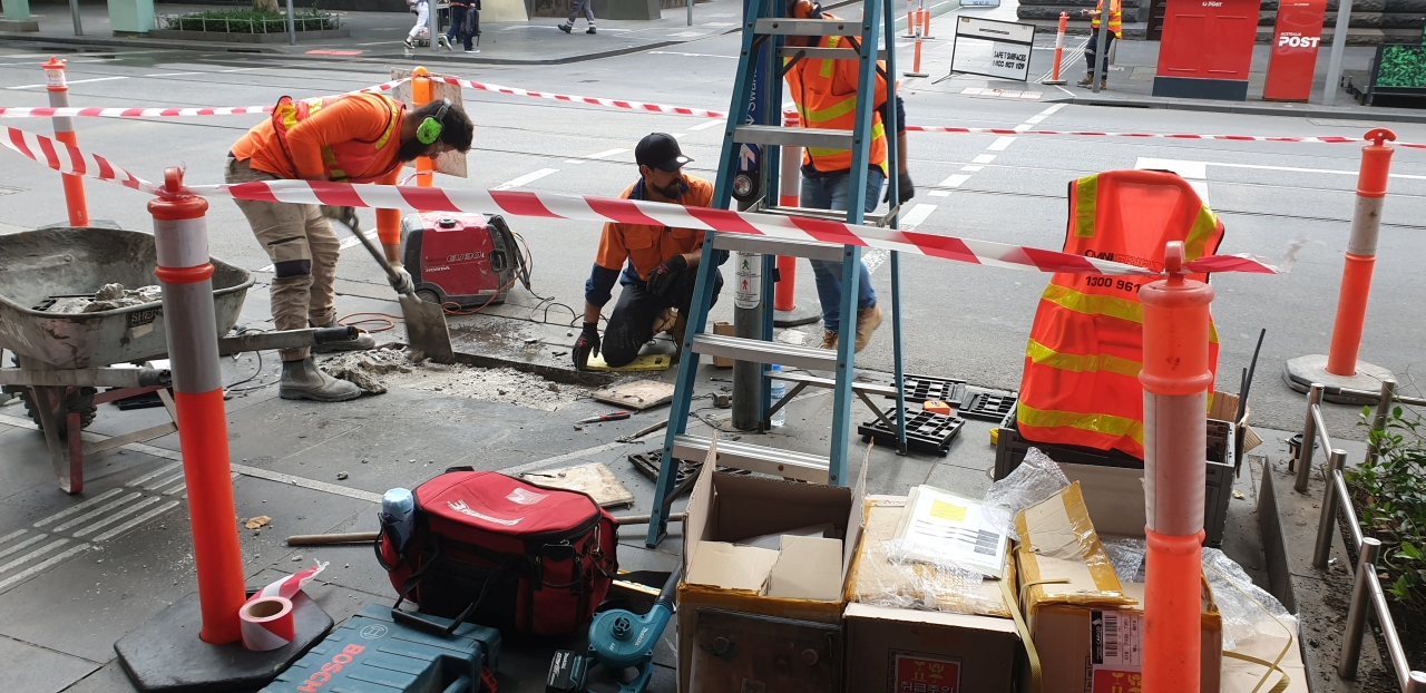 Installation of Vivacity LED Safety Tactiles on Swanston Street in Melbourne